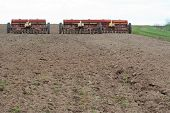 Seeding machines at field at sunny day.