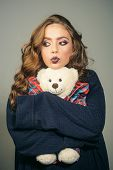 Beauty Salon And Hairdresser. Fashion Girl With Glamour Makeup Hold Toy Bear. Woman With Makeup And  poster