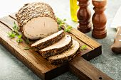 Roasted Pork Loin With Dry Rub Sliced On A Board poster