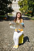 Overjoyed Traveler Tourist Woman In Yellow Clothes Hat Sitting On Suitcase Holding City Map Search R poster
