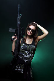 stock photo of girls guns  - Attractive and sexy army girl with assault rifle in sunglasses - JPG