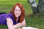 Young woman studing outside