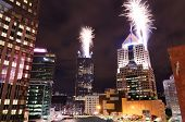 Fireworks launch from skyscrapers in downtown PIttsburgh, Pennsylvania, USA.
