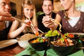 picture of chinese restaurant  - Young people eating in a Thai restaurant - JPG