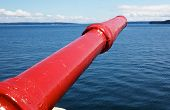 Bright red Tugboat Fire fighting Nozzle with Puget Sound in the background