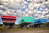 Large commercial fishing boats up on blocks in a dry dock in Gaspe, Quebec, Canada.