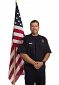 Uniformed Firefighter Standing Half Body Length Portrait In front of American Flag  Isolate on Withe