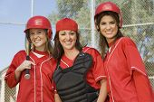 image of softball  - Group of young female softball players - JPG