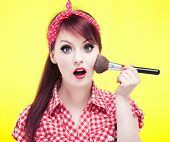 picture of rockabilly  - Cute pin up girl applying blusher - JPG