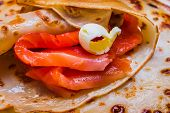 Pancakes With Smoked Salmon And Butter On Shrovetide