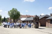 OSWIECIM - MAY 26: Jewish youth group visits the concentration camp in Oswiecim, Poland on May 26, 2013. Oswiecim was the largest German concentration camp on Polish territory during World War II.