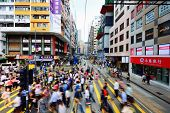 HONG KONG - OCTOBER 9: Pedestrians cross the Tramway tracks October 9, 2012 in Hong Kong, China. The