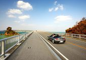 OKINAWA JAPAN - NOVEMBER 14: Vehicular traffic passes over Kurima Bridge November 14, 2012 in Okinaw