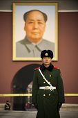 BEIJING, CHINA-DECEMBER 27: A guard is standing in front of the Tiananmen gate. The portrait of Mao