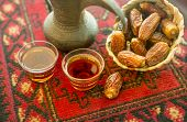 An arabic coffee pot and dates close up