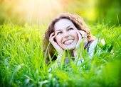 stock photo of pollen  - Beautiful Young Woman Outdoors Enjoying Nature - JPG