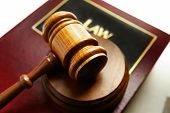 stock photo of law-books  - court gavel on top of a law book - JPG