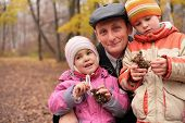 Grandfather With Grandsons In Forest In Autumn