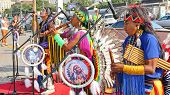 Native American Indian tribal group play music