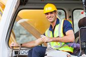 stock photo of heavy equipment operator  - cheerful excavator operator on construction site - JPG