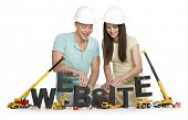 Website under construction concept: Cheerful man and woman building the word website along with cons