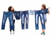 picture of jeans skirt  - Two teenage friends  hanging up fashionable jeans wear - JPG