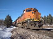 Freight train with orange locomotive
