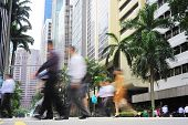 image of zebra crossing  - Unidentified businessmen crossing the street in Singapore - JPG