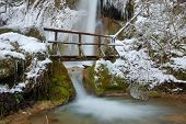 Bridge With Waterfall In Winter