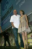 ANAHEIM, CA - MARCH 31: Marc Guggenheim and Willa Holland pose for photos at the 2013 Wondercon conv