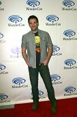 ANAHEIM, CA - MARCH 31: Colin Donnell arrives at the 2013 Wondercon convention press room at the Anaheim Convention Center on March 31, 2013 in Anaheim, CA.