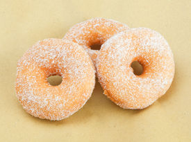pic of graff  - Donuts on beige paper background with studio lighting - JPG