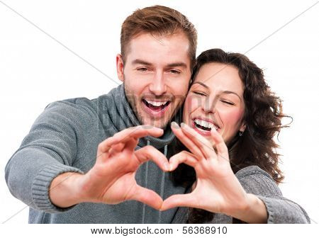 Valentine Couple. Portrait of Smiling Beauty Girl and her Handsome Boyfriend making shape of Heart b poster