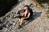 foto of drinking water  - Thirsty female hiker drinks some water from a bottle - JPG