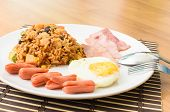American fried rice with pork sausage bacon and fried egg