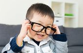 Asian little boy wear glasses