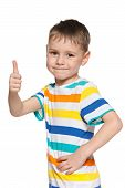 Cute Little Boy Holds His Thumb Up