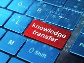 Education concept: Knowledge Transfer on computer keyboard background