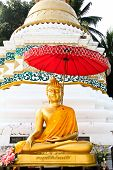 Golden Buddha Image In Front Of Pagoda In Wat Sri Chum