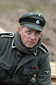 KIEV, UKRAINE -NOV 1: An unidentified member of Red Star history club wears historical German uniform during historical reenactment of WWII, Dnepr river crossing 1943, November 1, 2013. Kiev, Ukraine