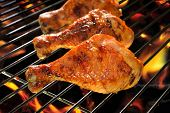 image of thighs  - Grilled chicken thigh on the flaming grill - JPG