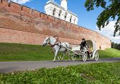 Novgorod Veliky, Russia - August 10, 2013: Horseback Riding Near The Wall Of Novgorod Kremlin. Novgo