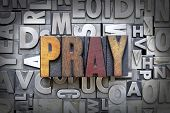 stock photo of praying  - The word pray written in vintage letterpress type - JPG