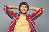Stylish young man in shirt and beanie hat
