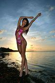 Bikini model posing sexy at the morning light