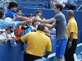 Two times Grand Slam Champion Andy Murray signing autographs after practice for US Open 2013