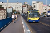 BELGRADE, SERBIA - AUG 15: Pedestrians and bus on Stari Savski bridge on August 15, 2012 in Belgrade