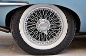picture of wagon wheel  - An English Classic Sports Car wire wheel with a chrome finish - JPG