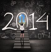 Businesswoman Getting Success In New Year 2014