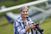 Young photographer taking picture in aerodrome